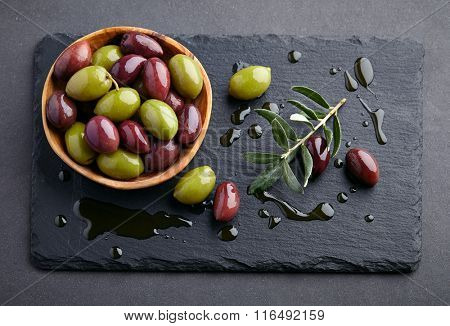 Olives on a graphite board
