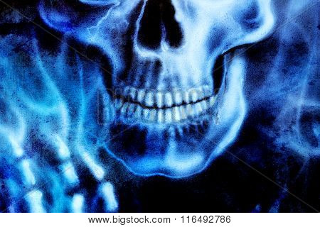 detailed skull and skeleton hand and blue fire, on black background.