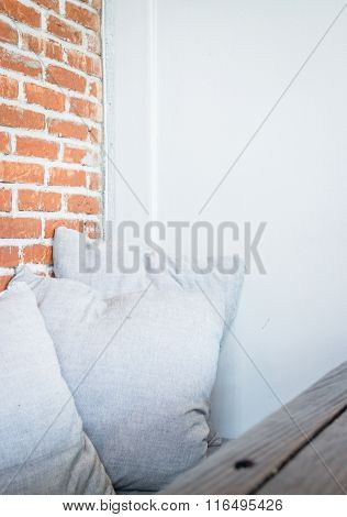 Grey Pillow On A Brick Wall Background