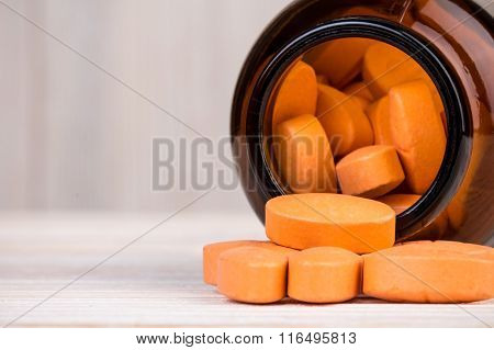 Orange Pills In Glass Container