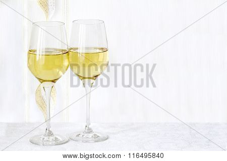 Two Glass  Wine Are Stand On The White Tablecloth