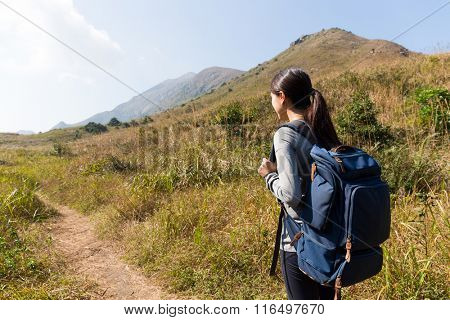 Rear view of woman go hiking
