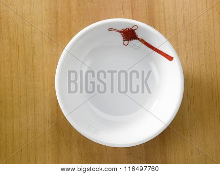 top view of  saucer on the wooden background