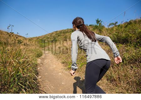 Young woman running at mountains