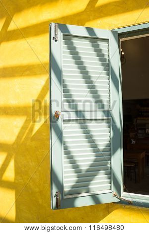 Window On Yellow Cement With Shadows