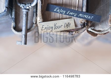 Enjoy every moment and Enjoy your life text
