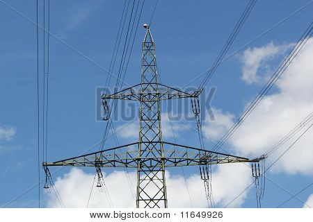 Electrical Pylon In A Cloudy Sky