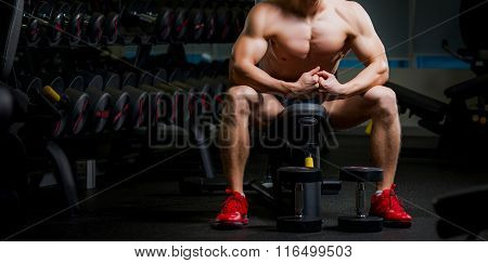 Muscular man sweating and looking tired