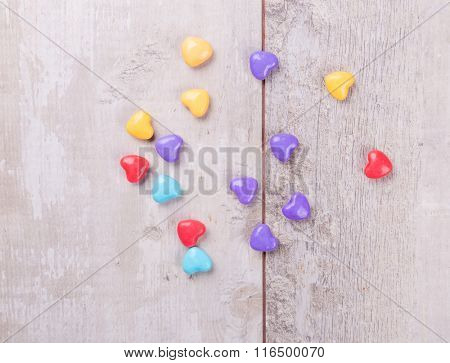 Candy hearts over wood. Valentines day background