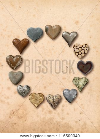 Various Hearts In A Circle Over Vintage Background
