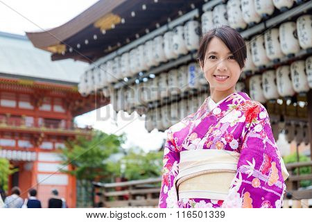 Asian woman wearing kimono at temple
