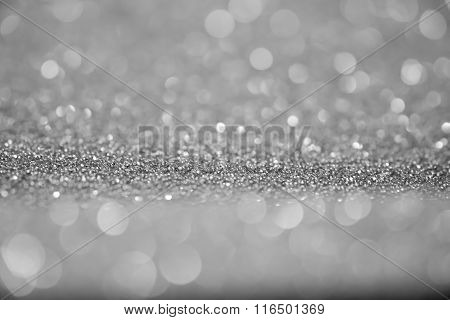 Twinkling Lights Abstract Blurry Background Bokeh Of Silver.