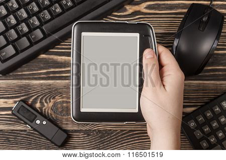 Miscellaneous office gadgets on wooden background