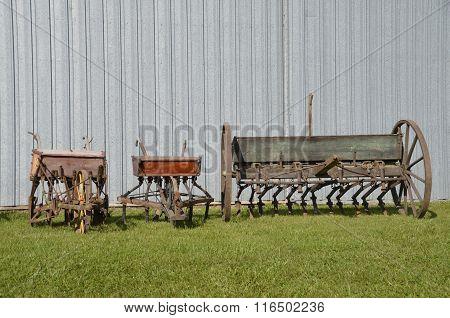 Three vintage seed box grain drills