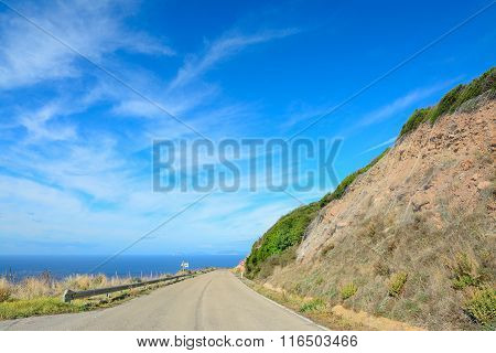 Winding Road By The Sea In Alghero