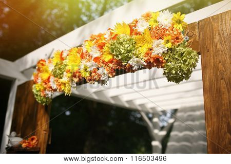 Stylish Decorated Rustic Arch With Flowers At The Reception In A Restaurant For A Wedding Ceremony