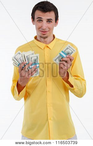 Rich man holding pile of money.