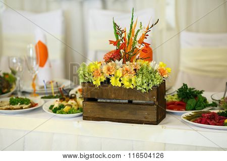 Stunning Unusual Decorated Centerpiece Table With Orange And Yellow Flowers For A Wedding In The Res
