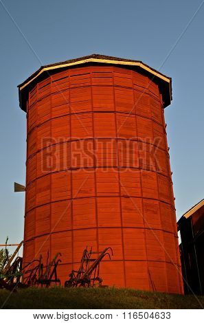Restored red wood silo