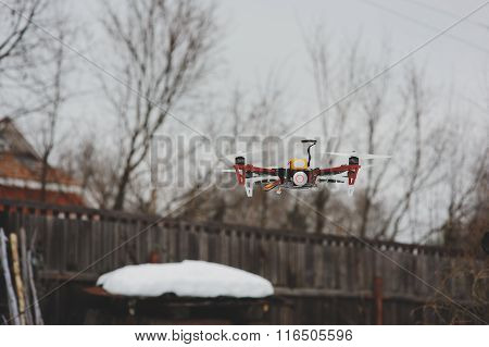 drone in aerial flight on countryside. Modern technologies for capturing photo and video. Winter day