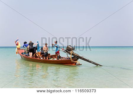 KATA BEACH, THAILAND - CIRCA FEBRUARY, 2015: Tourists on a cruise boat go to sea. Traveling by boat is a popular form of entertainment among tourists.