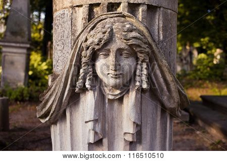 Old statue on grave in the Lychakiv cemetery of Lviv, Ukraine