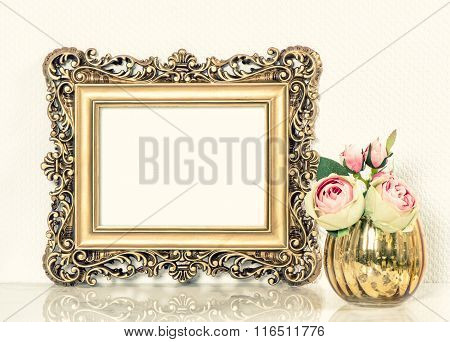 Golden Baroque Picture Frame And Roses Flowers Bouquet. Retro Style