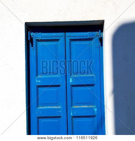 In Santorini Europe Greece  Old Architecture And Blue    Venetian Blind Wall