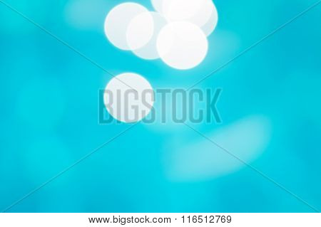 Sunny water bokeh blue background.