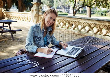 Happy woman student using for learning laptop computer while preparing for lectures in University