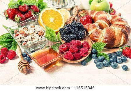 Breakfast With Croissants, Muesli, Fresh Berries. Healthy Nutrition