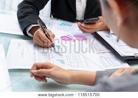 Businesswomen working and analyzing data and statistic