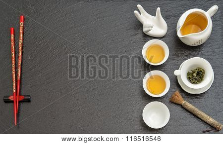 Tableware For Traditional Tea Ceremony. Teapot, Cups And Red Chopstick