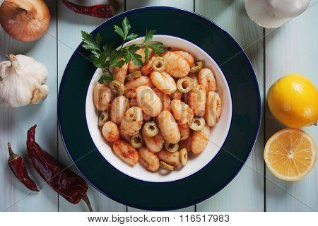 Gnocchi di patata, italian potato noodles with olives and tomato sauce