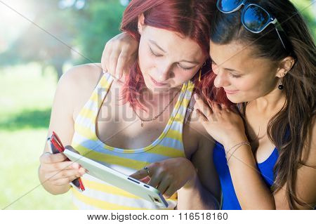 Two girls and tablet