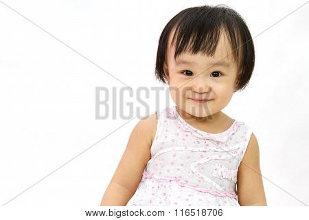 Chinese Little Girl Smiles For A Portrait In Studio