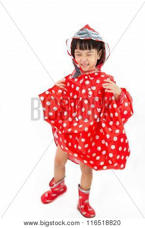 Chinese Little Girl Wearing Raincoat And Boots
