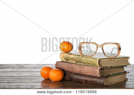 Book And Mandarin On Isolated Background
