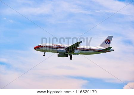HONG KONG - JUNE 04, 2015: China Eastern Airlines aircraft landing. China Eastern Airlines Corporation Limited is a major Chinese airline operating international, domestic and regional routes