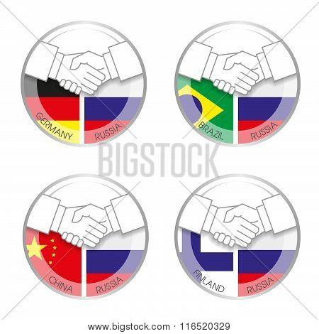 Symbol Handshake Russia With Other Countries. Icons With A Handshake On The Background Of Different