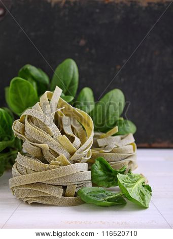 Pasta With Spinach Green On A White Wooden Table