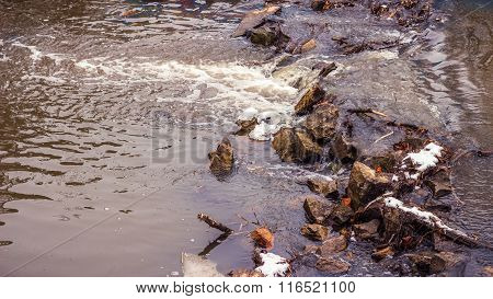 Streaming Muddy Water In Small River At Early Spring
