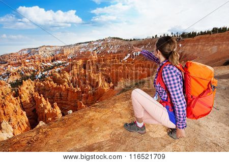 Nice hiker woman point to Bryce canyon with hand