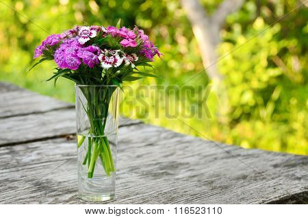 Bouquet Of Small Carnations On A Table In The Garden