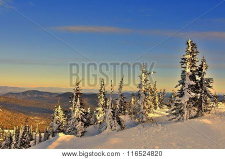 Winter Landscape In The Mountains At Sunset
