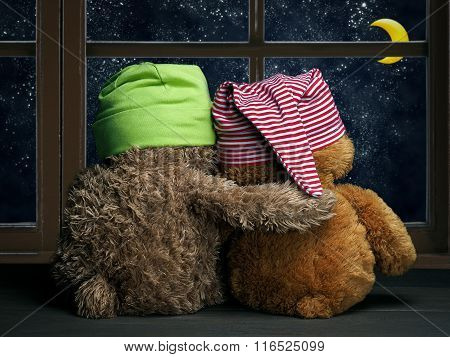 Two friends or lovers look out the window at night, the stars and the moon