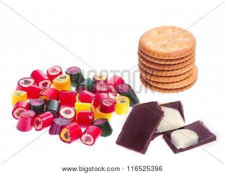 Mount Caramel Colored Candies And Pieces Of Milk And White Chocolate And A Stack Of Biscuits Isolate