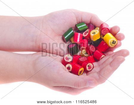 Mount Caramel Colored Candies With Cool Designs In Two Hands Isolated White