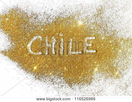 Blurry inscription Chile on golden glitter sparkles on white background