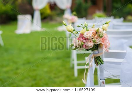 White chair with a bunch of flowers